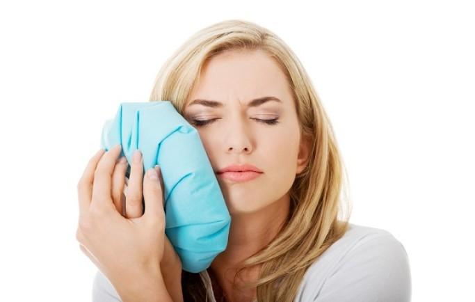 Các biểu hiện của việc mọc răng khôn là thế nào?