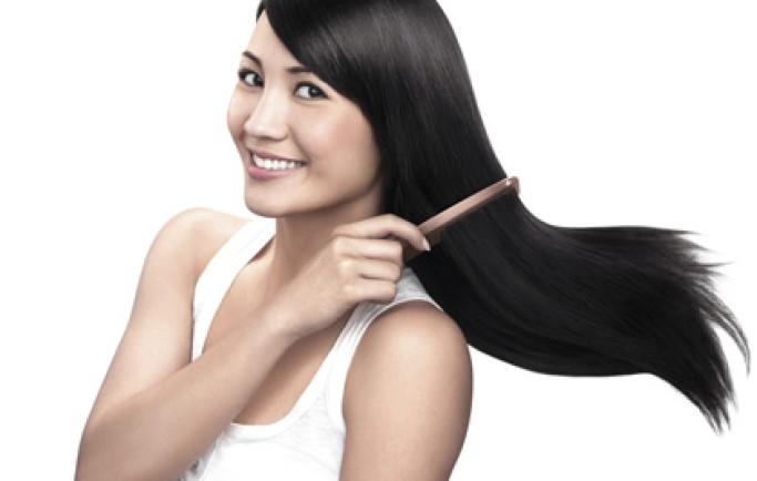 Sử dụng dầu gội trị rụng tóc chuyên dụng